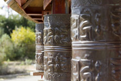 Prayer wheels in Tibet Stock Photography