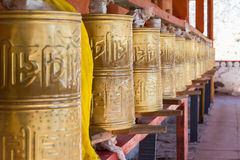 Prayer wheels of tibet. In chinese temple Stock Photos