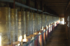Prayer wheels in Tibetan monastery Stock Images