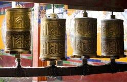 Prayer wheels, Tibetan monastery. Prayer wheels close up in a Tibetan monastery Stock Photo