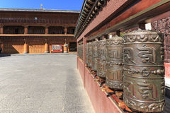 Prayer wheels in a tibetan temple of ShuHe Old Town, a Unesco World Eritage Site not far from Lijiang Old Town. Lijiang, China - November 14, 2016: Prayer wheels Stock Image