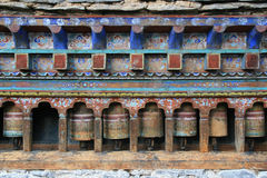 Prayer wheels were installed in the courtyard of a temple (Bhutan) Royalty Free Stock Image