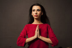 Prayer woman with folded hands Stock Photo