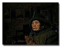 Prayer. The 80 year old woman, lonely and helpless. She prays god who can bring her comfort every moment. In her heart, who will make its presence or power for Stock Photo