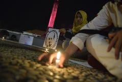 Prayerful handling för anställningtjänsteman till representanterna KPK Royaltyfri Fotografi