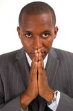 Prayerful Man. This is an image of a businessman, with a prayerful stare. This image can be used to represent Peace Maker, Faith , Business Vision etc Royalty Free Stock Photo