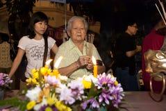 Prayers. KUALA LUMPUR, MALAYSIA- May 16, 2011. A devotees praying on the eve of Wesak Day Celebration Royalty Free Stock Photography