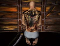 Prayers. 3d rendering of a praying Samurai with tattoo as illustration Royalty Free Stock Image
