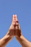 Prayers. Hands praying to the sky Royalty Free Stock Photos