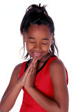 Prayers. Young African American says her prayers Royalty Free Stock Photos