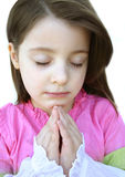 Prayers. Little girl praying Royalty Free Stock Photography