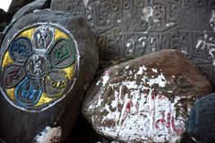Prayer Rocks. Prayers carved on rocks outside a Buddhist monastery Royalty Free Stock Images