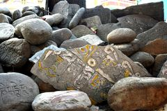 Prayer Rocks. Prayers carved on rocks outside a Buddhist monastery Royalty Free Stock Photos