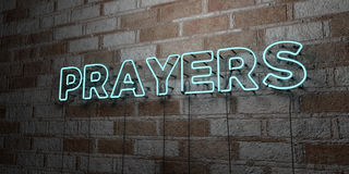 PRAYERS - Glowing Neon Sign on stonework wall - 3D rendered royalty free stock illustration Stock Photo