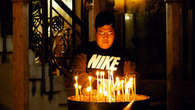 Prayers lighting candles in Holy Sepulcher Church Royalty Free Stock Photo