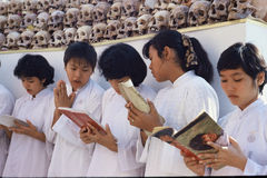 Prayers at Mass cremation in Thailand. Ethnic Chinese ceremony, exhuming unmarked and paupers' graves from cemeteries, cleaning and cremating remains Stock Images
