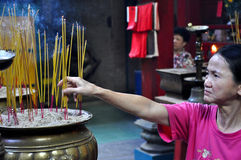 Prayers in a pagoda. Vietnam. SAIGON - FEB 18: Unidentified people offering incense sticks for the Gods in the Vietnamese Jade Emperor Pagoda. On February 18 Stock Photo