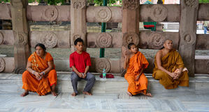 Prayers sitting at the Mahabodhi Temple Complex in Gaya, India Royalty Free Stock Images