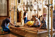Prayers at the Stone of Anointing in the Holy Sepulchre Church Royalty Free Stock Photography
