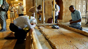 Prayers at the Stone of Anointing in Jerusalem Royalty Free Stock Images