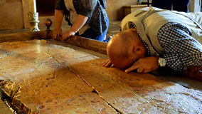 Prayers at the Stone of Anointing in Jerusalem Stock Images
