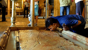 Prayers at the Stone of Anointing in Jerusalem Royalty Free Stock Photography