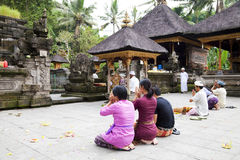 Prayers at Tirtha Empul, Bali, Indonesia. Image of devotees offering prayers and going through a hindu ritual at a temple known as Tirtha Empul at Bali royalty free stock images