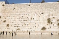 Prayers and tourists near Jerusalem wall Stock Photos