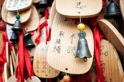 Prayers and wishes on wooden plates hanged in a temple. stock photo