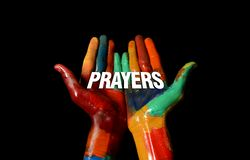 Prayers word concept on Multi Colors Painted hand Stock Photography