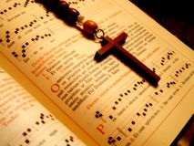 Praying. A prayer book and a rosary Royalty Free Stock Photography