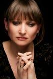 Praying. Emotional portrait of a praying woman, studio shot Stock Photography