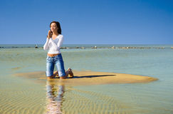 Praying-2. Girl on a beach Stock Image