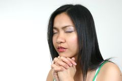 Praying 2. Pretty young asian girl praying to god Royalty Free Stock Images
