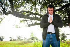 Praying. A man with hands clasped has a spiritual experience in the outdoors Royalty Free Stock Photos