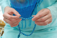 Praying. Female hands with bead while praying Royalty Free Stock Photo