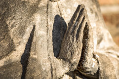 Praying. Hands of an antique statue Royalty Free Stock Photo