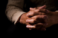 Praying. A shot of hands of an old man praying stock photography