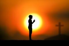 praying stock afbeelding