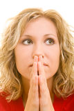 Praying. Blonde woman praying with her hands folded Royalty Free Stock Photos