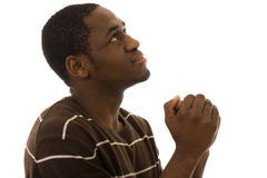 Praying. A young man looking up to God royalty free stock image