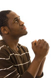 Praying. African young man praying isolated on white royalty free stock photography