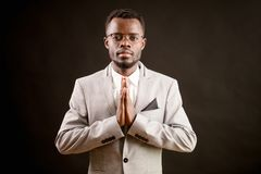 Praying Africanamerican man in good clothing. Ask the God for health. Praying Africanamerican man in good clothing. Ask the God for good luck, success, health royalty free stock photo