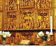 Praying Altar inside Danish Church. A Praying Altar with a Gold Metal Plate Carving of the Story of Jesus Christ inside a Church in Denmark Stock Photos