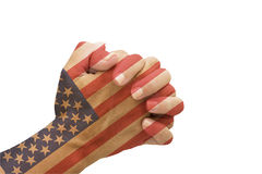 Praying for America. Female hands praying with the American flag on them isolated on white Royalty Free Stock Image