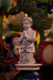 Praying Amongst the Knick Knacks. Close up of a statue of a boy kneeling in prayer Royalty Free Stock Image