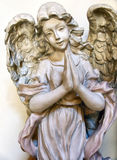 Praying Angel. Statue of angel with folded hands in prayer Royalty Free Stock Photography