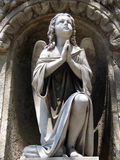 Praying angel. Statue of a winged praying angel Royalty Free Stock Photography