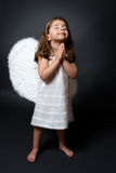 Praying angel with hands together in worship Stock Image