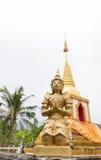 Praying angel statue beside the buddhist pagoda Stock Photo
